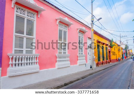 CARTAGENA, COLOMBIA - FEBRUARY 25, 2015: Beautiful colorful facades of colonial houses in Cartagena de Indias - stock photo