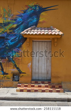 CARTAGENA, COLOMBIA - JANUARY 26, 2015: Colourful murals decorating the wall of a house in the Getsemini area of the historic city of Cartagena in Colombia