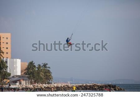 CARTAGENA - JANUARY 25.  A very talented boy is Kitesurfing on January 25, 2015 in Cartagena, Columbia. - stock photo