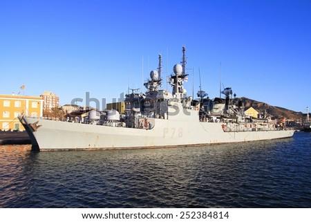 CARTAGENA, SPAIN - JANUARY 24: Coastguard P78 CAZADORA of the Spanish Navy docked in the port of Cartagena in the Mediterranean province of Murcia, on january 24, 2015 in Murcia. - stock photo