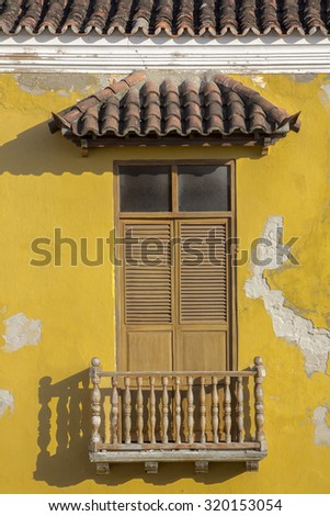 Cartagena - the colonial city in Colombia is a beautifllly set city, packed with historical monuments and architectural treasures. The picture present facade of the colonial house with balconies - stock photo