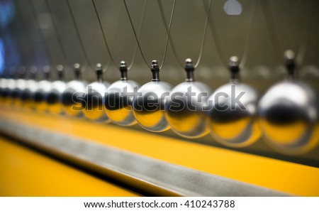 Cartesian impulse conservation law experiment metallic balls - stock photo