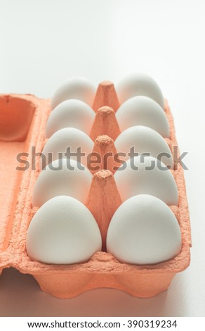 Carton of organic eggs with instant photograph. Selective focus - stock photo