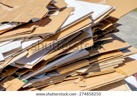 cartons waiting to be picked up by the garbage trucks. recycling of waste paper. - stock photo