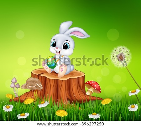Cartoon Easter Bunny painting an egg on tree stump in summer season background - stock photo