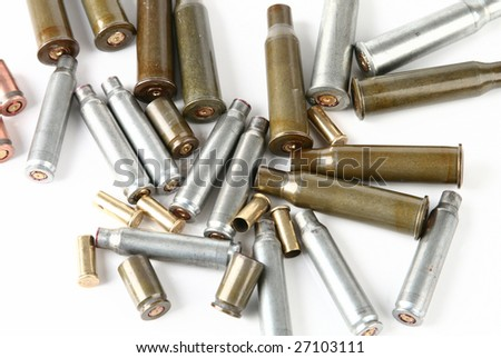 cartridge case of different weapons and pistol bullets - stock photo