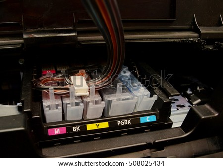 Cartridges an inkjet printer with an installed continuous ink supply system