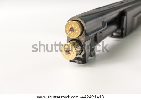 cartridges 12 gauge lying on a light background in close up view side. - stock photo
