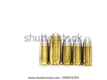 cartridges of .45 ACP full metal jacket and 9mm lead round nose pistols ammo, Bigger is better concept - stock photo