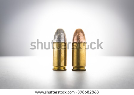 cartridges of  9mm pistols ammo,  full metal jacket and lead round nose bullets - stock photo
