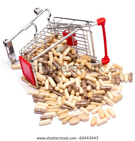 Carts on a white background filled with pills - stock photo