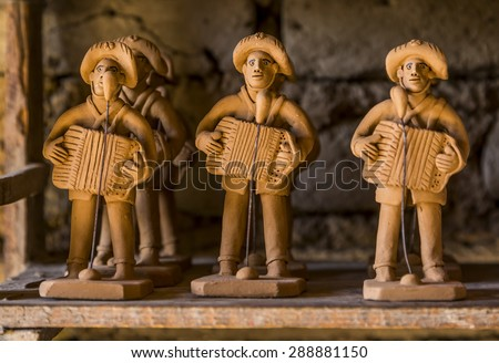 CARUARU, BRAZIL - MAY 6: Clay sculpture representing a typical Brazilian Forro player very common in the northeast of Brazil photographed in Caruaru, Pernambuco, Brazil on May 6, 2015. - stock photo