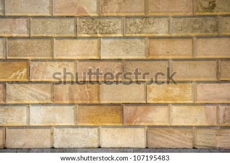 carved bricks in a wall full frame