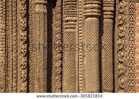 Carved columns at the temple,  Durbar Square, Nepal - stock photo