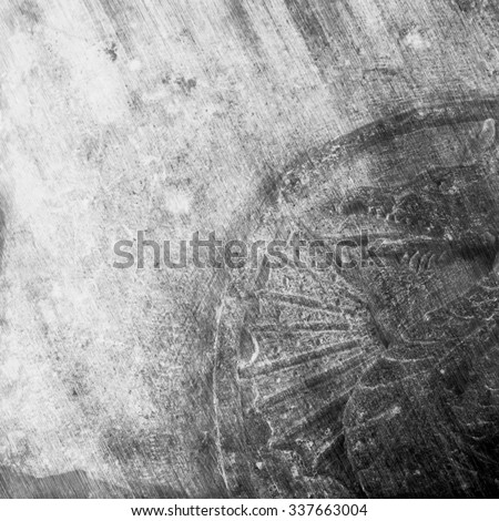 Carved dragon symbol on a medieval stone - stock photo