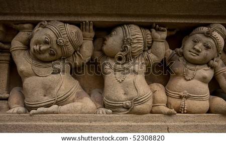 carved figures of dwarfs in Kelaniya Temple, Sri lanka