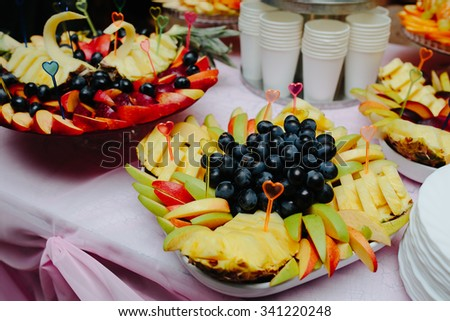 Carved fruits arrangement. Fresh various fruits. Assortment of exotic fruits. Fresh fruits decoration