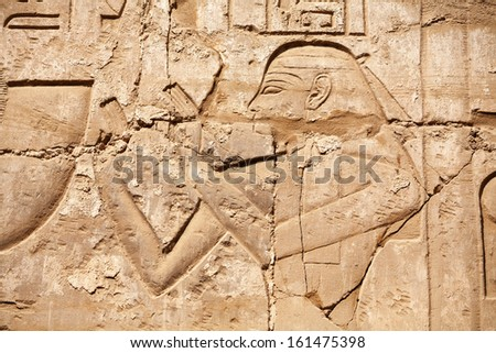 Carved male figure on a wall. Karnak Temple, Luxor, Egypt - stock photo