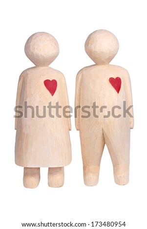 Carved man and woman with hearts made from wood - stock photo