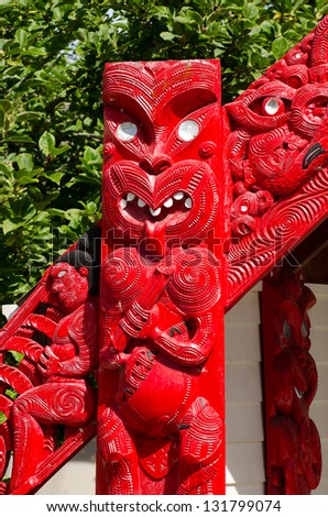 Carved maori marae - meeting house in Taumarunui, New Zealand. - stock photo