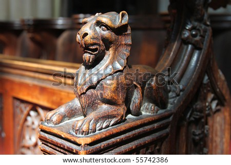 Carved oak lion on arm of pew, Bath Abbey, England