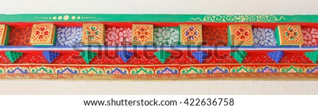 Carved ornamental ceiling details in a Tibetan home - stock photo