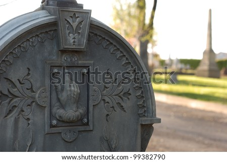 Carved, ornate headstone in a cemetery. - stock photo