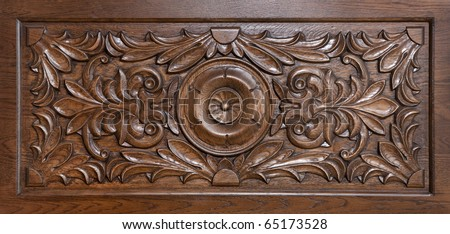 Carved pattern on wood, element of decor - stock photo