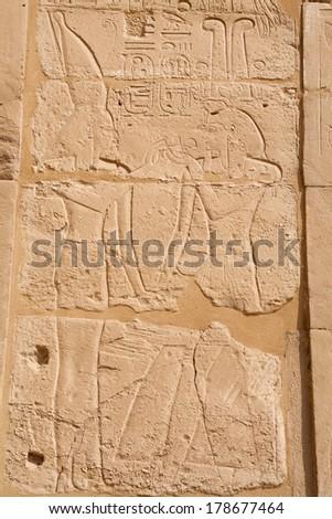 Carved Pharaoh figure on a wall. Karnak Temple, Luxor, Egypt - stock photo