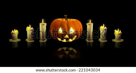 Carved pumpkin and 6 candles. Halloween image. - stock photo