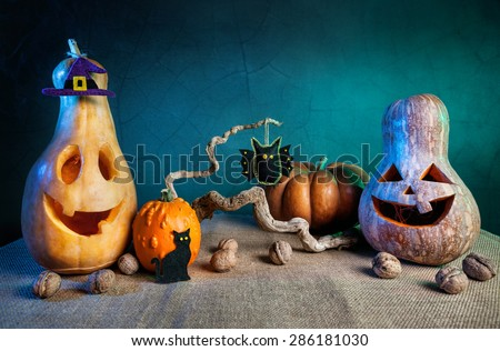 Carved pumpkins and handmade felt toys decoration at Halloween party  - stock photo
