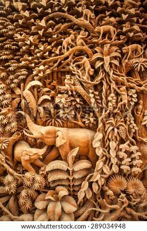 Carved Thai animals on the wood frame