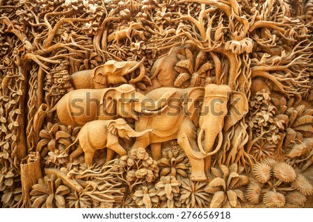 Carved Thai elephant on the wood - stock photo
