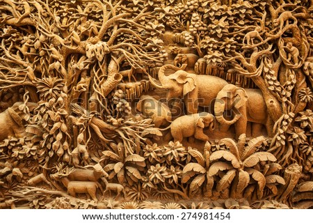 Carved Thai elephant on the wood frame - stock photo