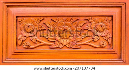Carved wood wall - stock photo