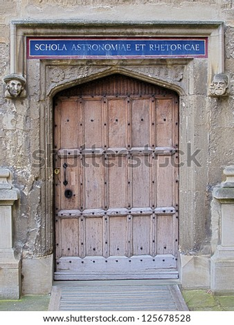 Carved wooden door at entrance to School of Astronomy and Rhetoric, Bodleian Library, Oxford, United Kingdom. - stock photo
