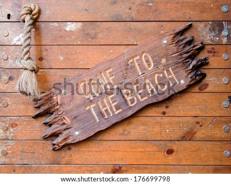 Carved wooden sign Gone to the Beach. - stock photo