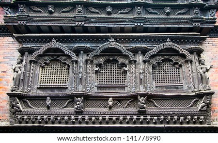 Carved wooden window from 9 th century on Bhaktapur palace, Kathmandu valley,  Nepal - stock photo