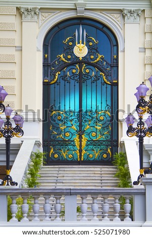 Carving of Thai Palace door in blue color. Bangkok palace, Thailand.