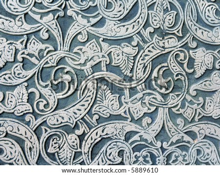 Carving pattern on old wall - stock photo