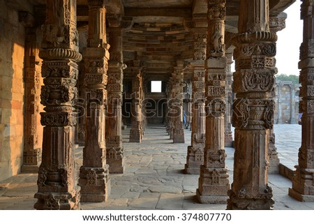 Carving Sandstone Columns in the courtyard of Quwwat-Ul-Islam mosque inside Qutub Minar complex Delhi India