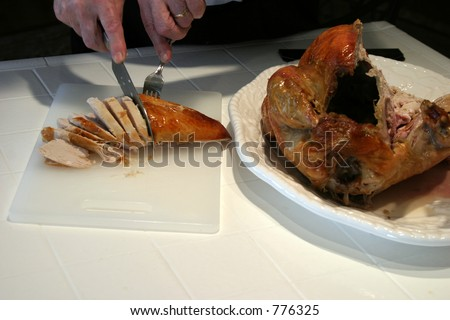 carving the holiday (thanksgiving, christmas, and more) Turkey - stock photo