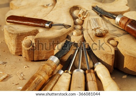 carving tool closeup on wooden background - stock photo