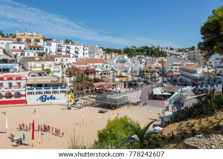 CARVOEIRO, PORTUGAL- July 31, 2017: Tourists and locals enjoying the beach and town in Carvoeiro town square.