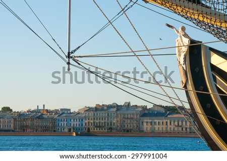 Caryatid in the bowsprit of a big sailing ship on a river in Saint Petersburg city in Russia - stock photo