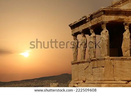 Caryatids on the Athenian Acropolis at sunset, Greece - stock photo