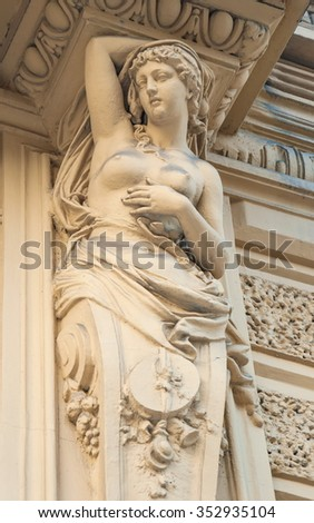 Caryatids sculpture adorns the old house on the street of St. Petersburg
