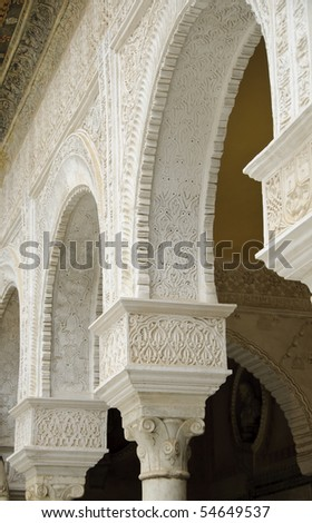 Casa de Pilatos is one of the most beautiful palaces in Seville. It was mainly built in the 16th century using a mixture of Italian Renaissance and Spanish Mudejar style.Detail of the decorated patio. - stock photo