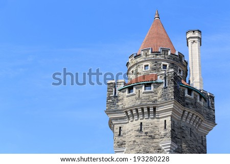 Casa Loma towers on blue sky in Toronto, Canada. - stock photo