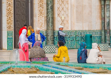 CASABLANCA, MOROCCO, APRIL 2, 2015: Local people gather on the outside grounds of Hassan II Mosque or Grande Mosquee Hassan II  - stock photo
